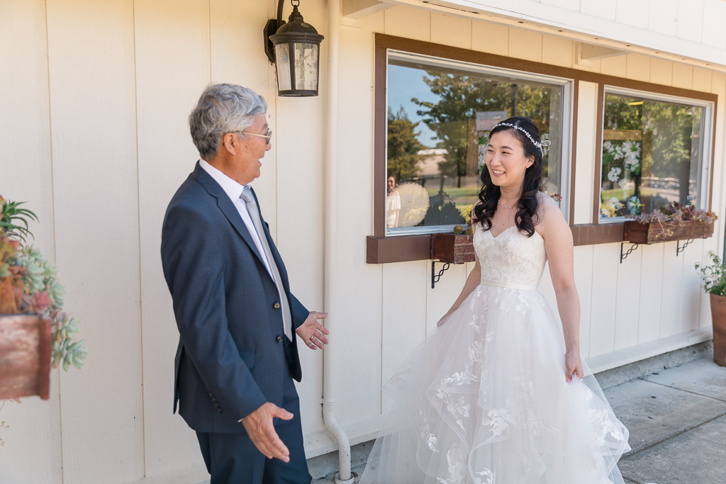 dad seeing the bride in her wedding gown
