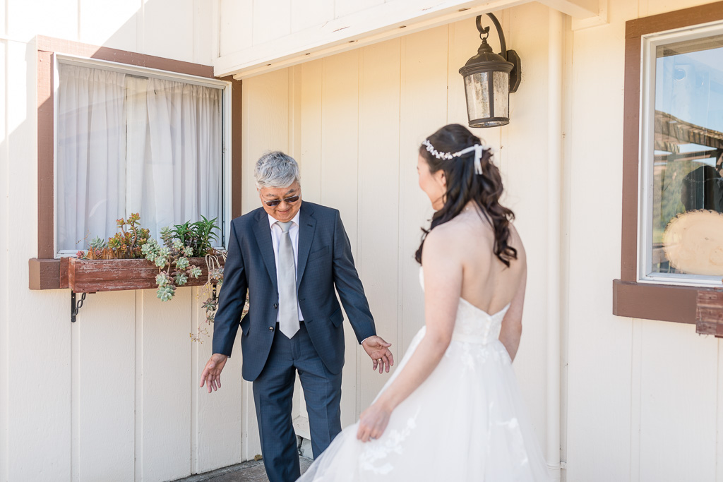 bride and father did a first look and dad's reaction was priceless