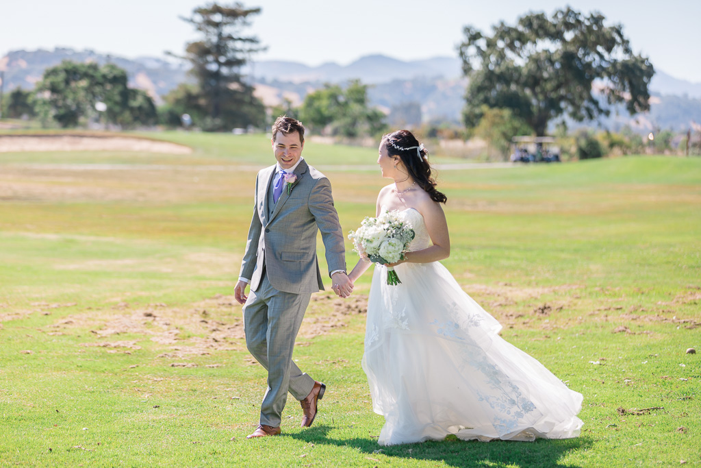 bride and groom strolling on the Kennedy Park golf course