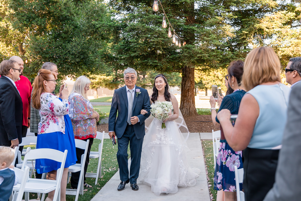 bride walks down the aisle with her father - Fairview wedding