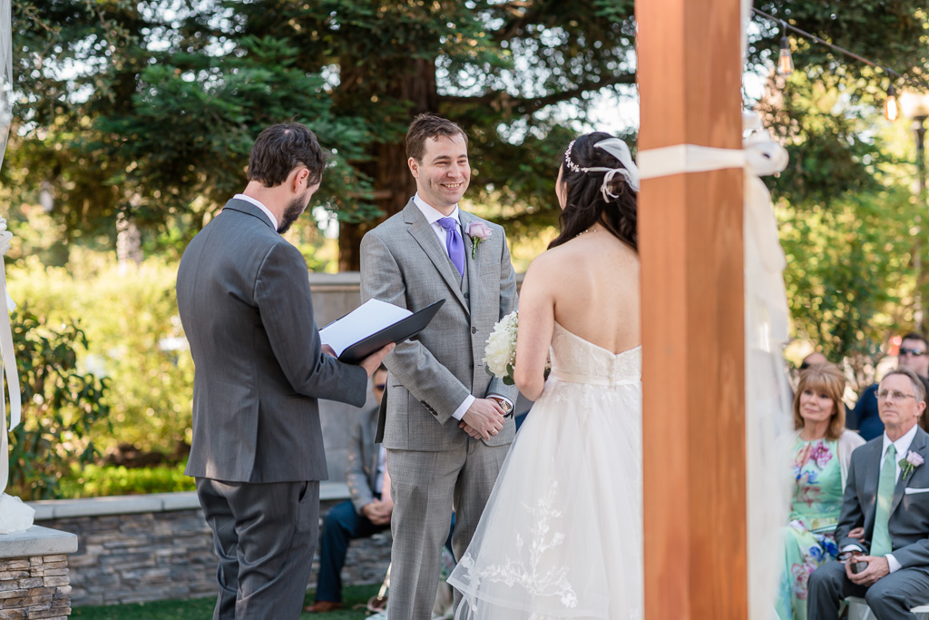groom adoring his bride during the ceremony