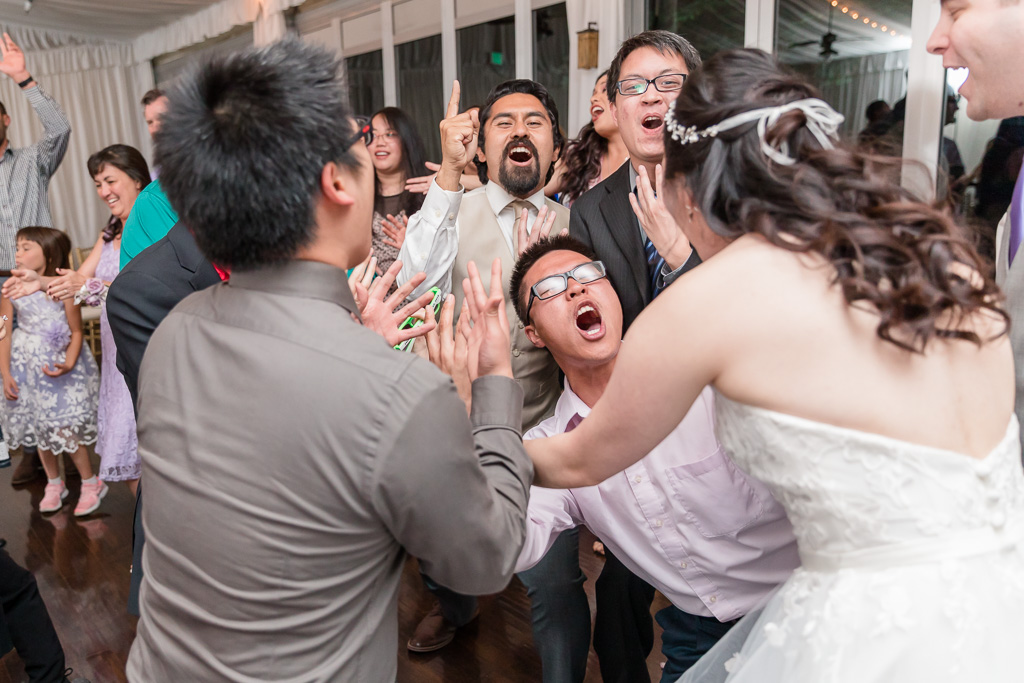 bride dancing with her friends during reception