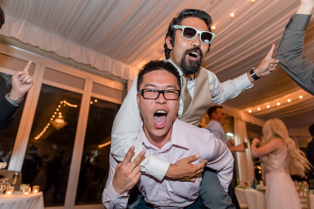 wedding guests' piggy back ride