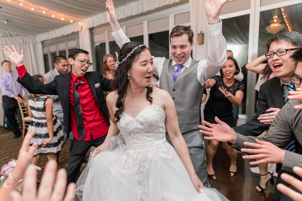 bride and groom owning the dance floor surrounded by their guests