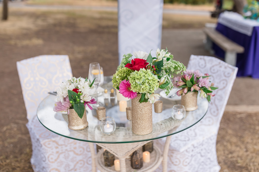 a private table decorated with flowers, candles and lanterns