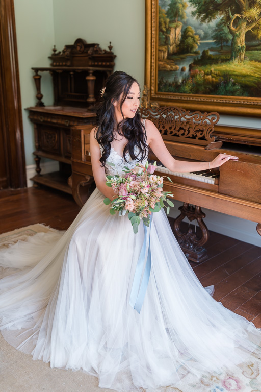gorgeous bride by the vintage piano
