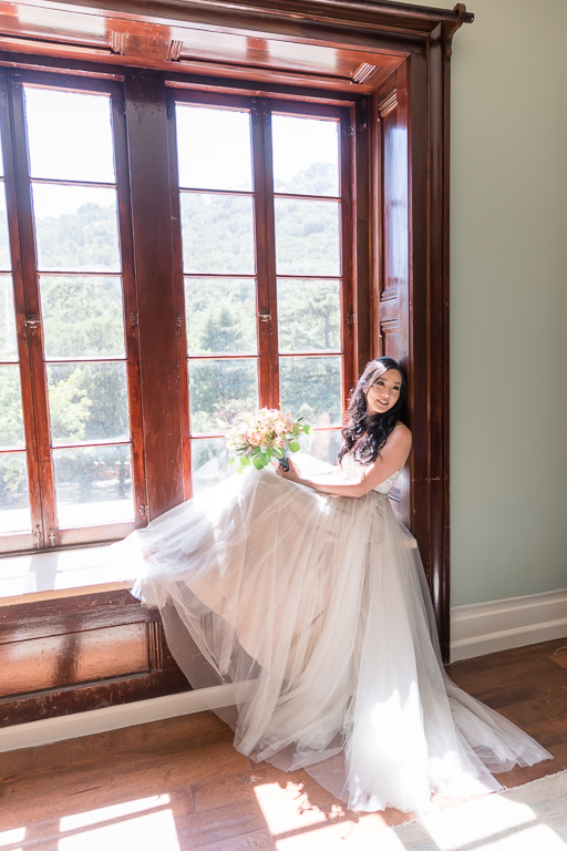 stunning bride by the window