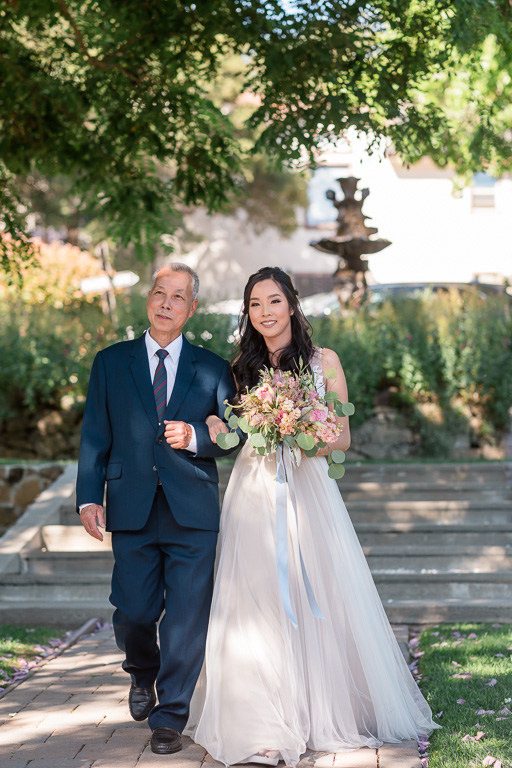 bride escorted down by her father