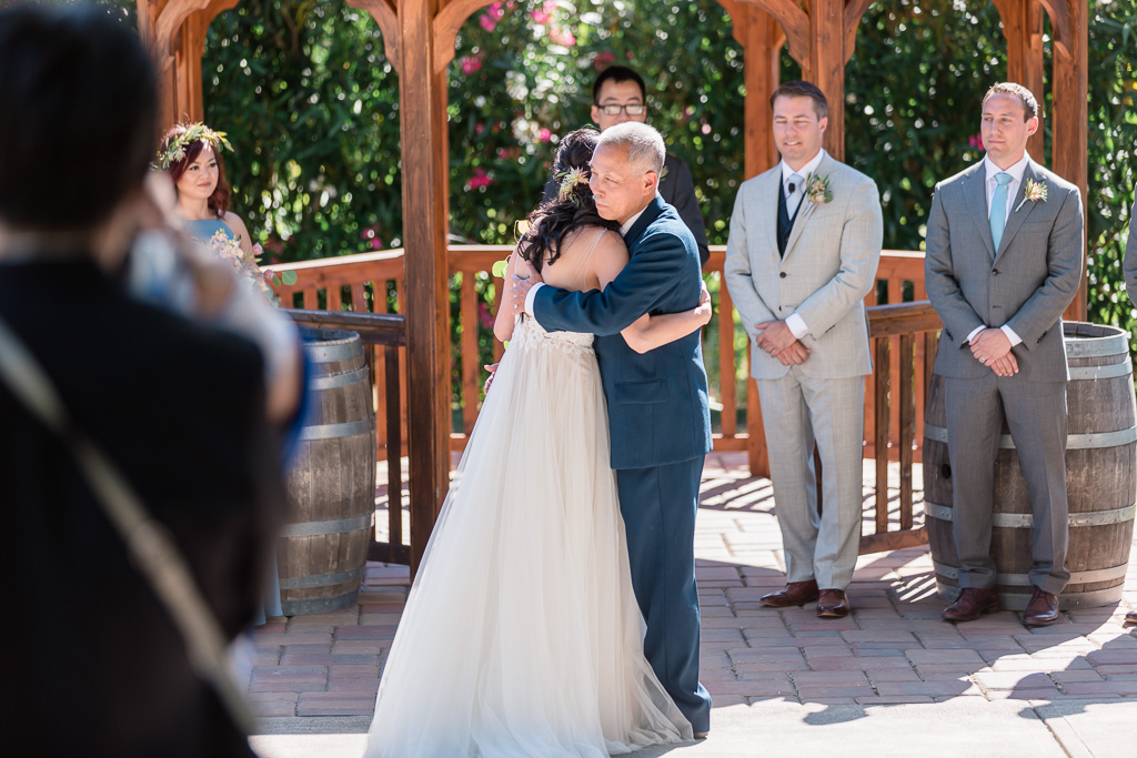 bride hugging father before he gives her away for the ceremony