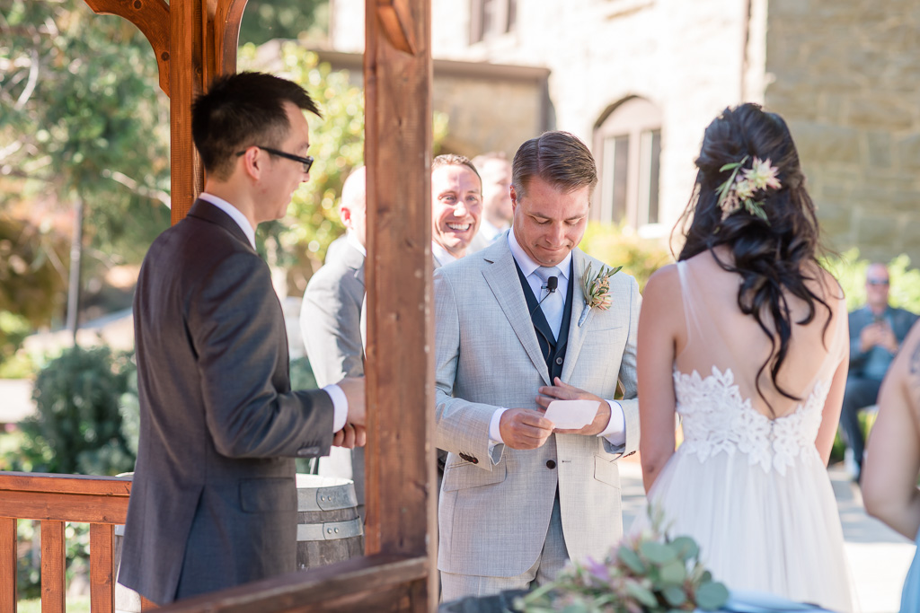 groom reading his personal vows