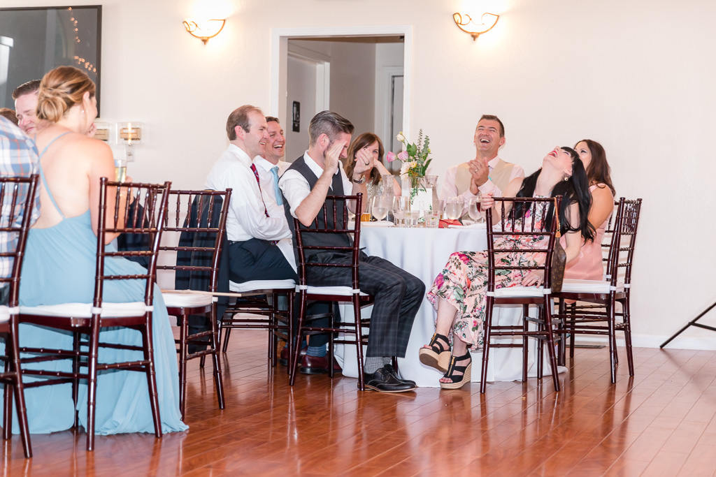 wedding guests laughing hard