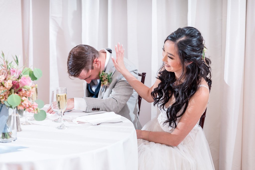 newlyweds laughing at the speech