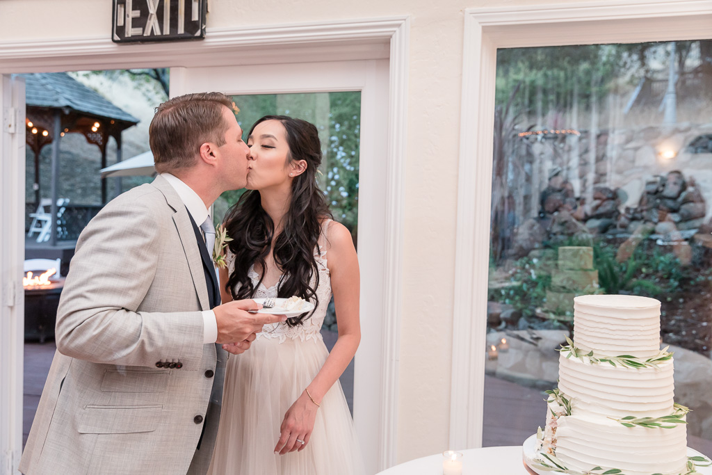 a kiss after feeding each other cake
