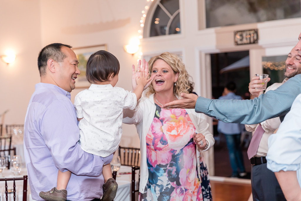 high-five with a toddler wedding guest