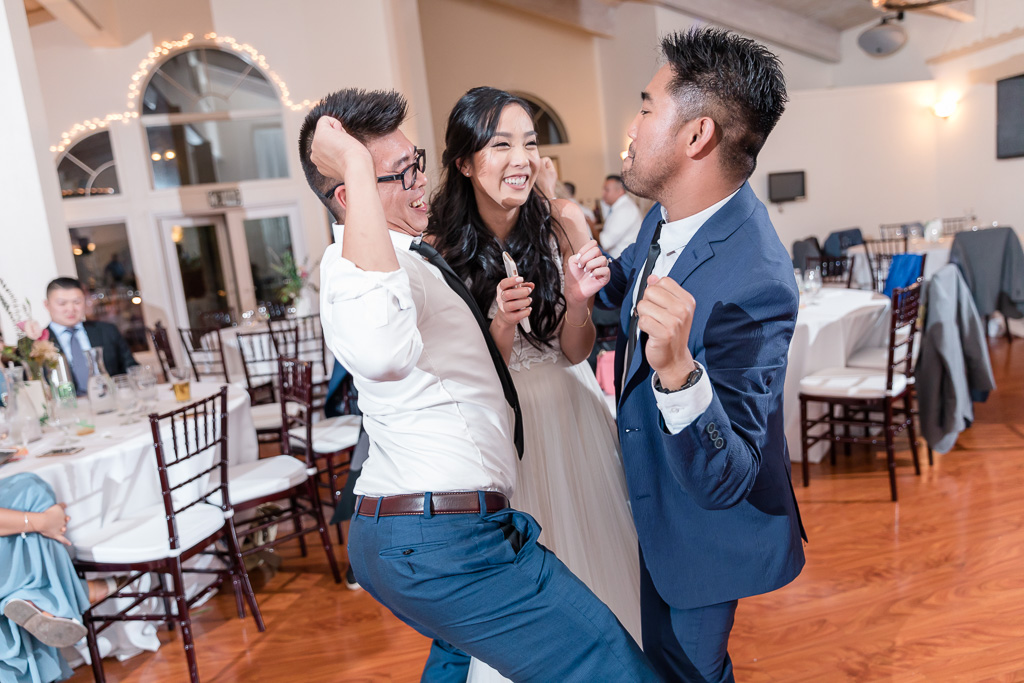 funny wedding guests dancing with the bride