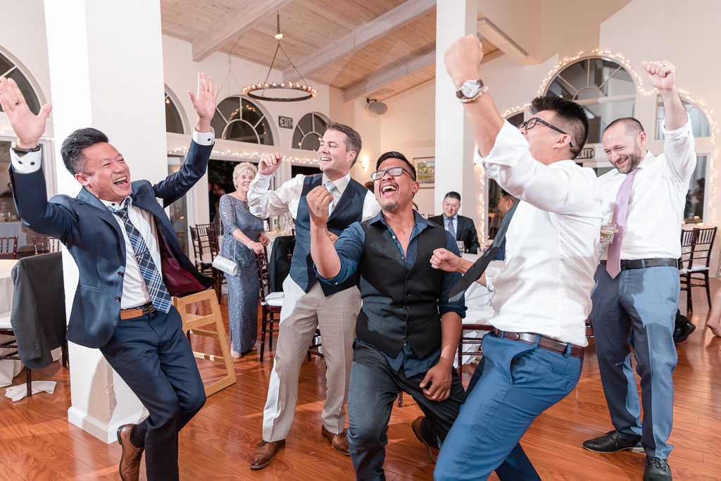 groom dancing with his buddies during wedding reception