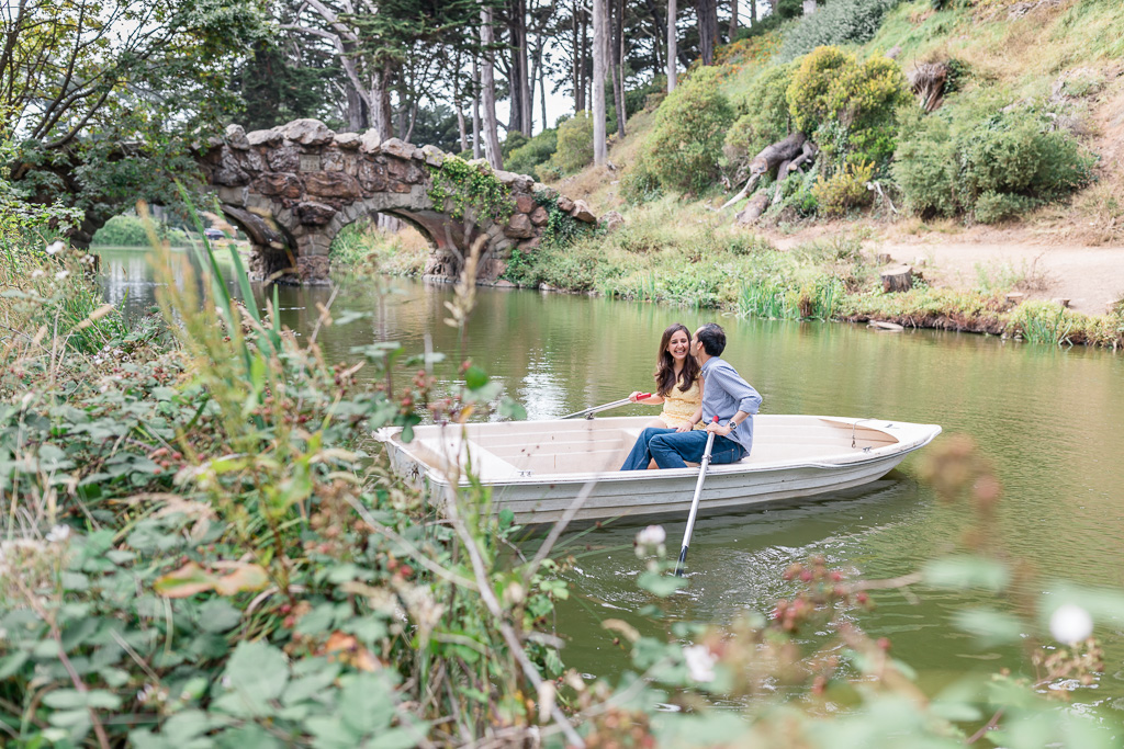 stow lake engagement photo in a row boat
