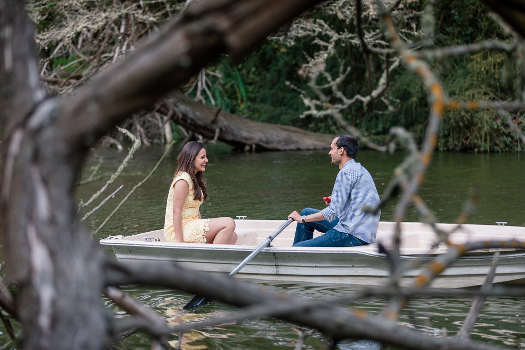 engagement photo in a paddle boat