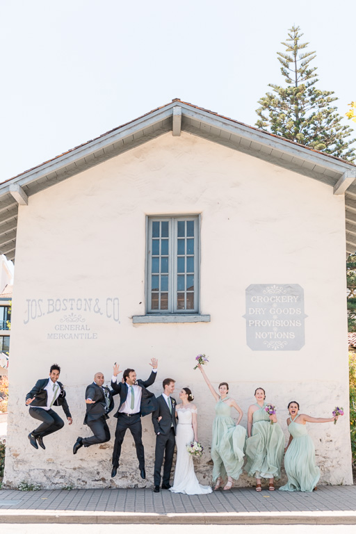 Fun jumping photo of the wedding party in Monterey
