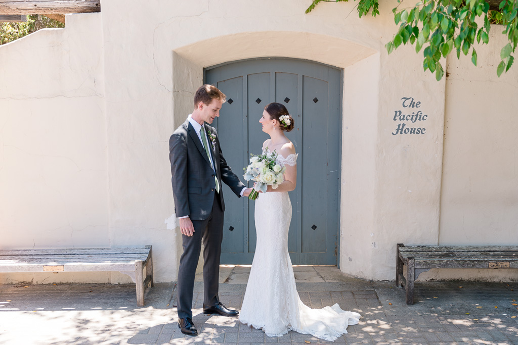 Monterey garden wedding - Bride and groom seeing each other the first time on their wedding time