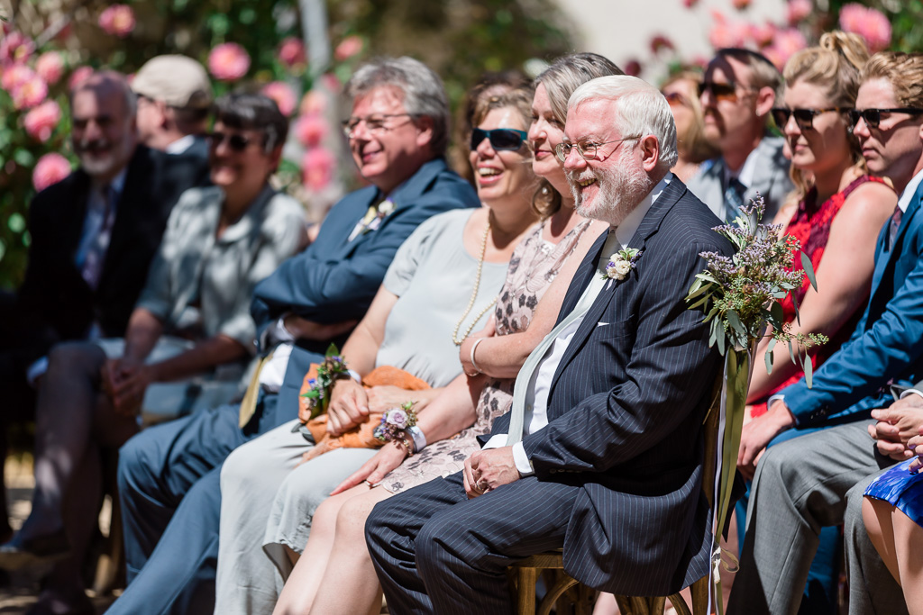Candid shot of the family and guests' reaction during ceremony