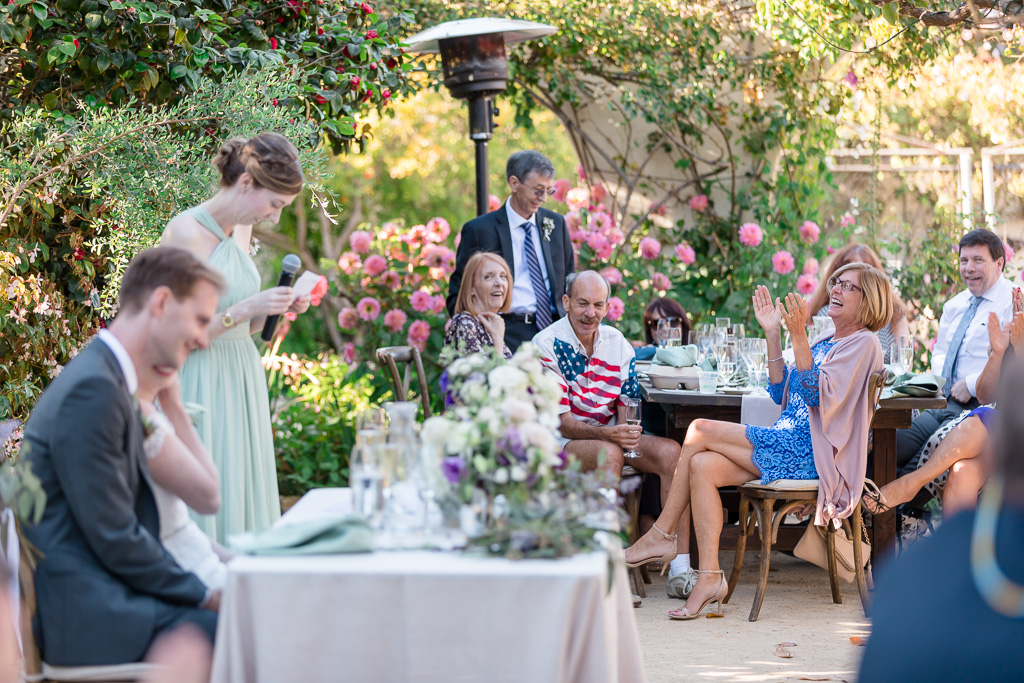 Cute moment during a beautiful garden wedding reception in Monterey