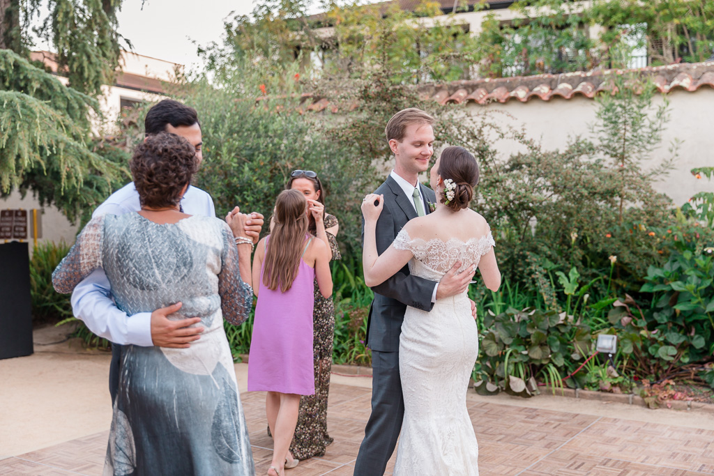 Bride and groom dancing with the guests