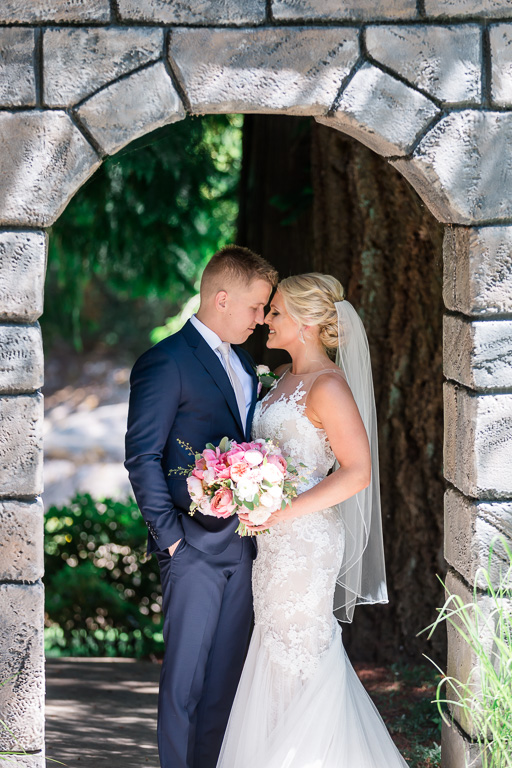 a moment together under a stone structure