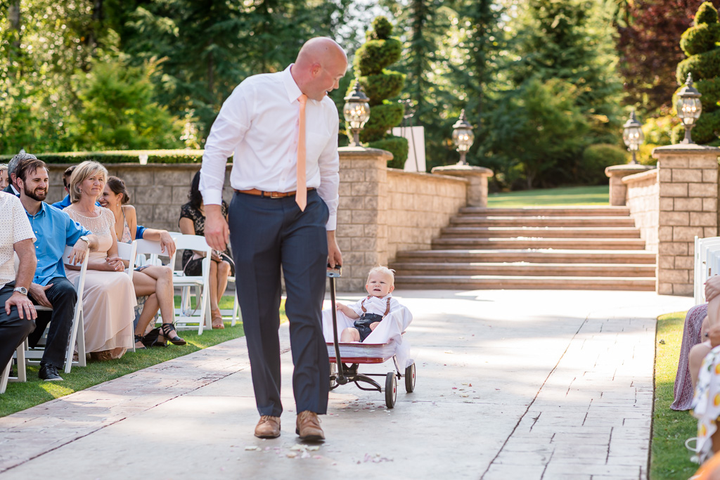 adorable baby ring bearer in his cute little carrier