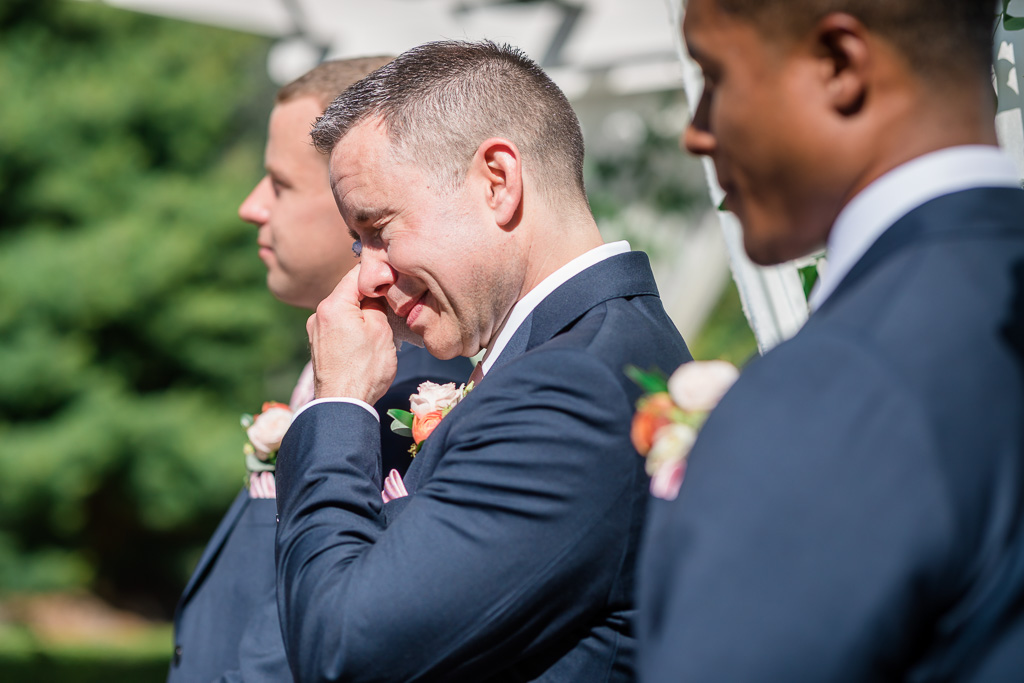 groomsman crying during the vow exchange