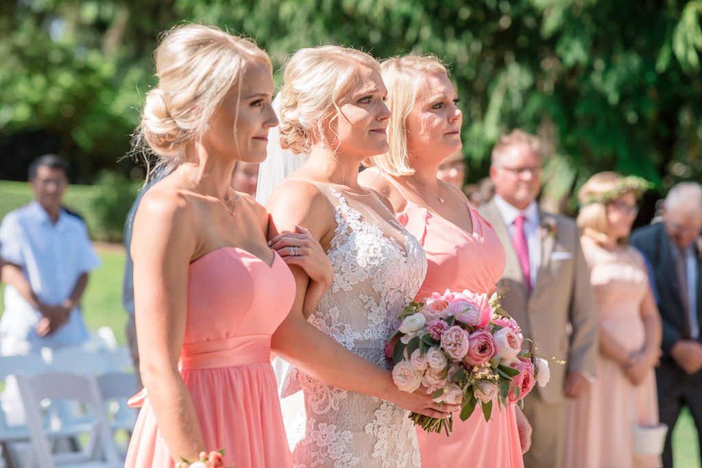 bride and her sisters walking down the aisle