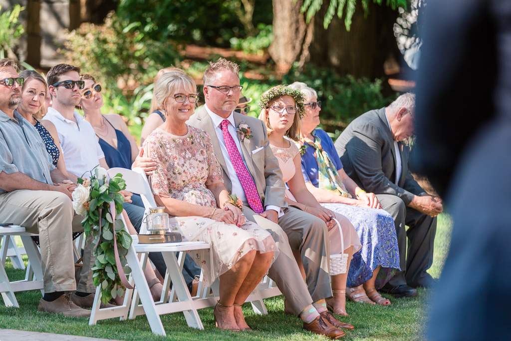 parents and guests' reaction during the lovely wedding ceremony in Puyallup garden