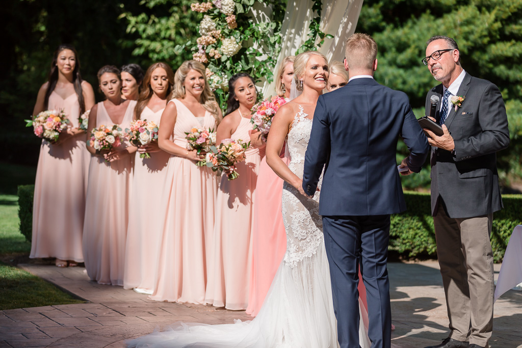 beautiful wedding ceremony in a summer garden in Seattle
