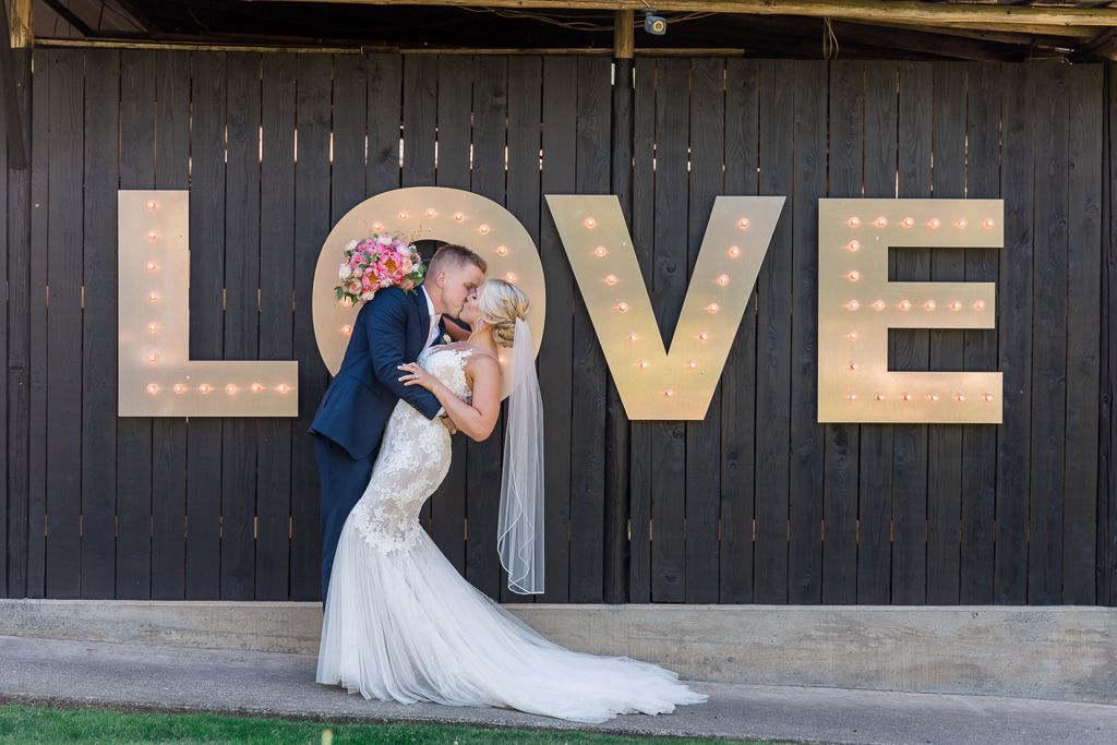 lit up love sign for wedding photo