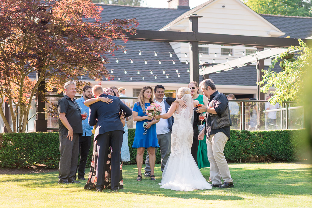 newlyweds greeting their guests on the property