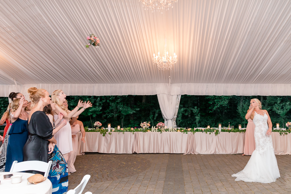 epic bouquet toss at the Rock Creek Gardens wedding reception