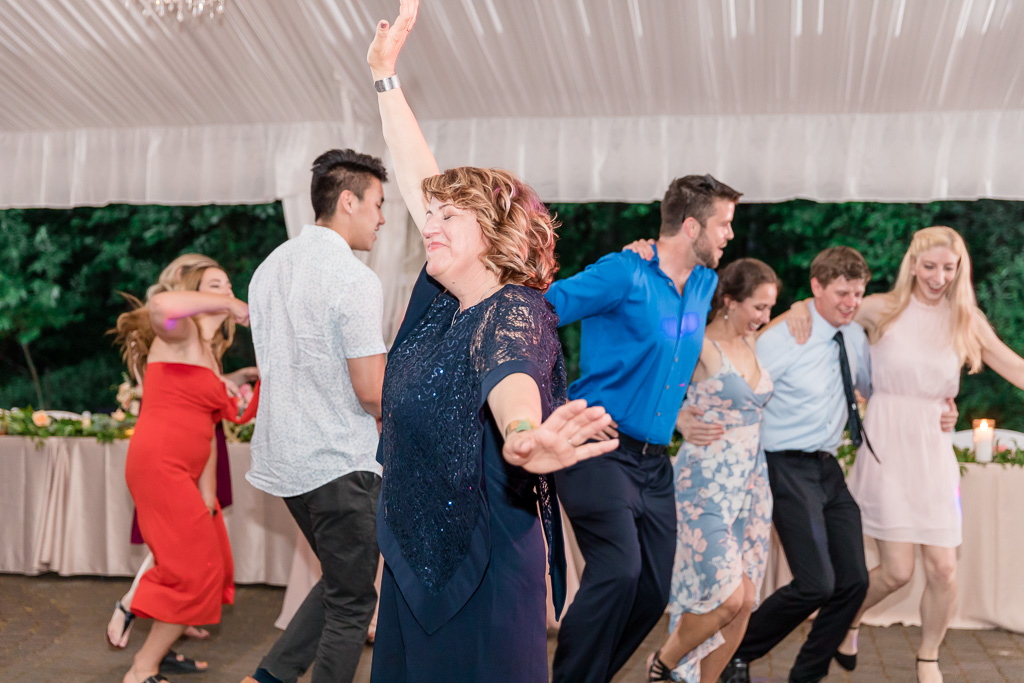 mother of the groom enjoying her dance