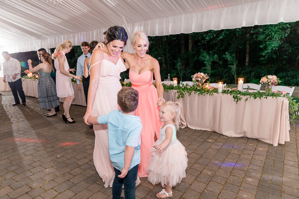 bridesmaids dancing with the little ones
