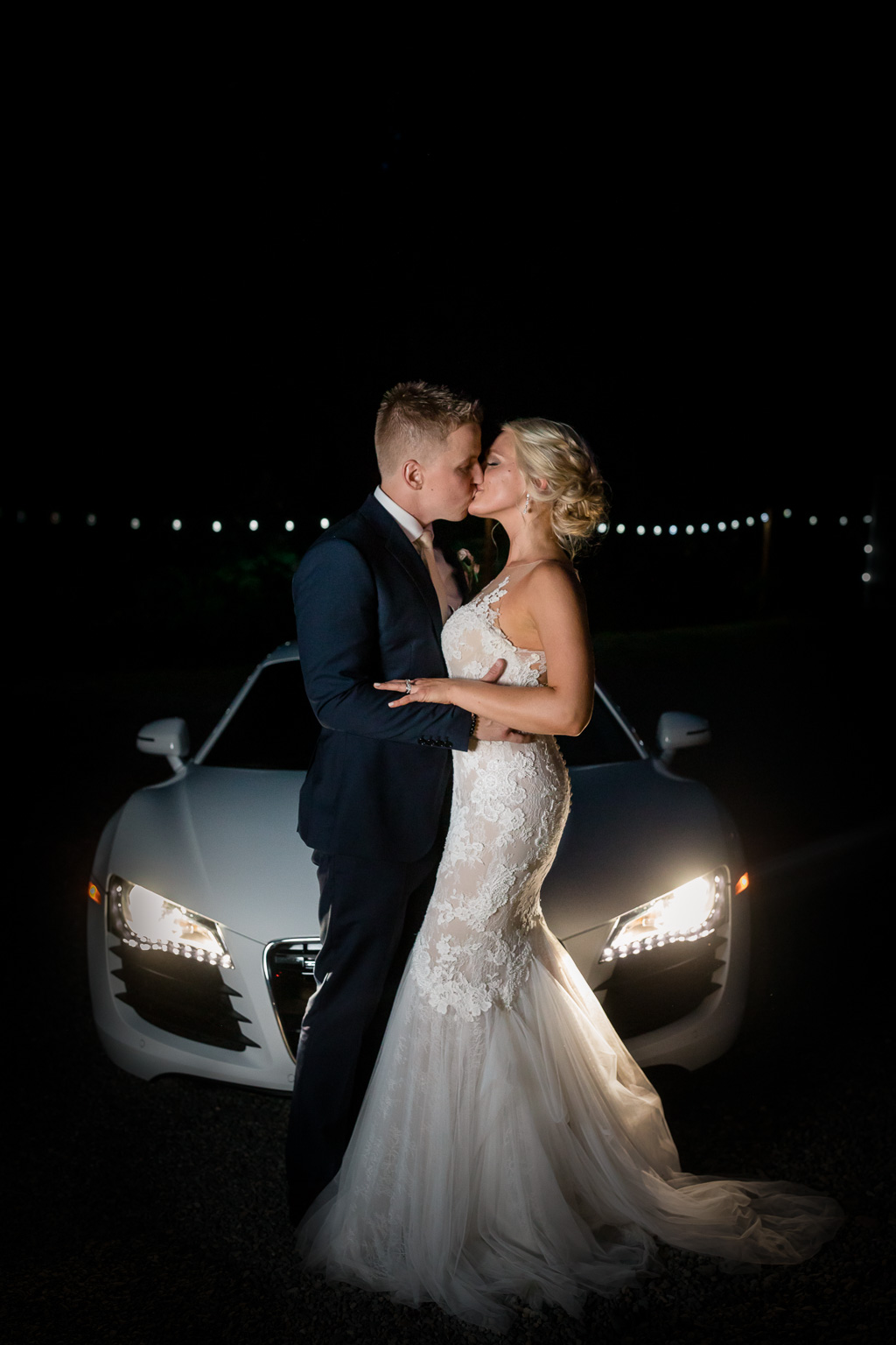 creative night photo of a Rock Creek Gardens wedding of the bride and groom in front of their car
