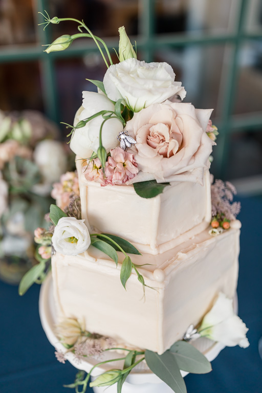 pastel color wedding cake with a cute little bee on top