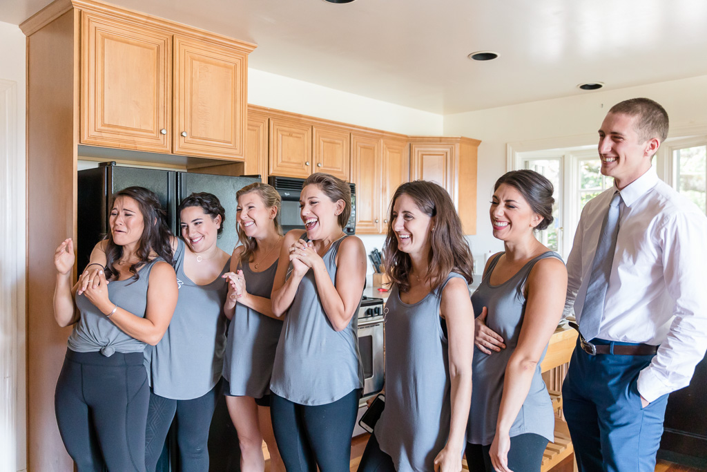 bridesmaids' reaction when seeing bride in her dress for the first time