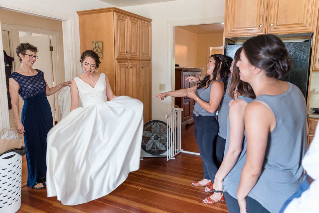 bride doing a first look with her bridesmaids