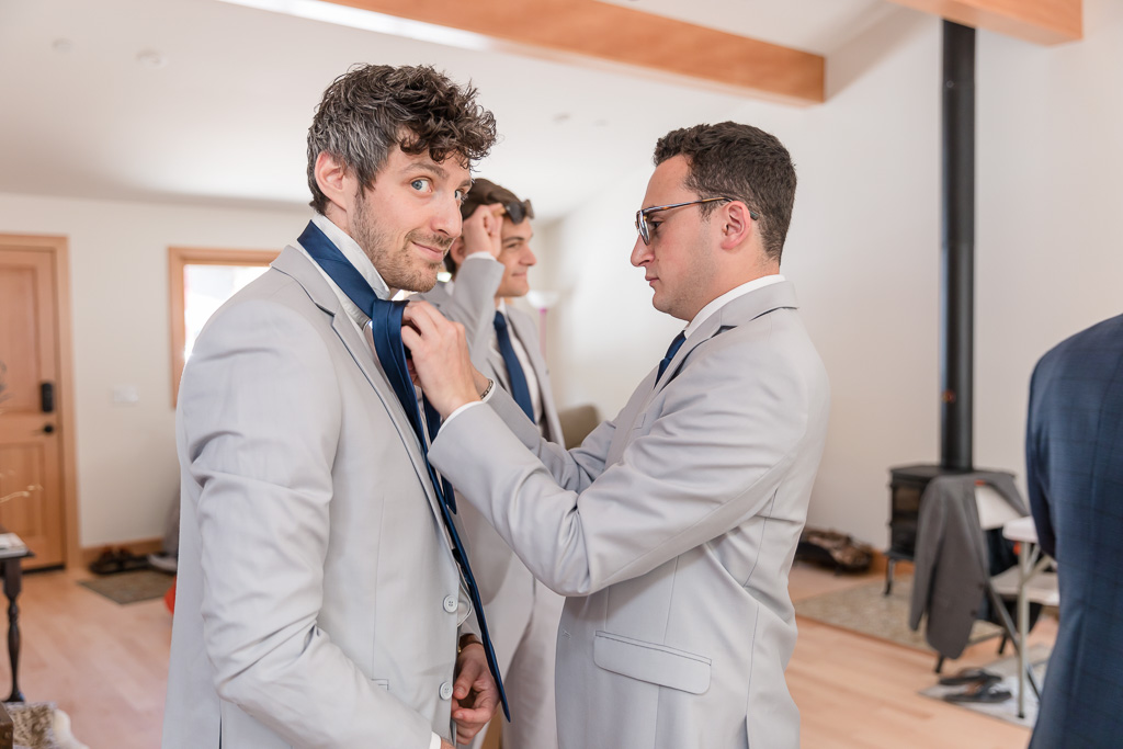 groomsmen fixing each other up