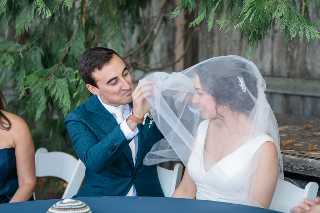 cute facial expression of the groom at the Jewish veiling ceremony