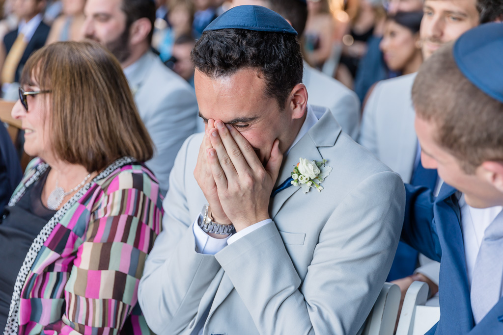 groom's brother getting very emotional during the wedding ceremony