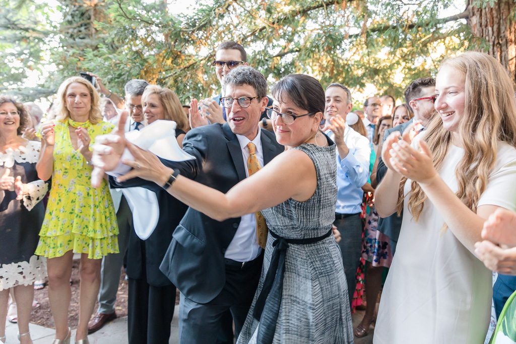 guests surprise the bride and groom with silly dances