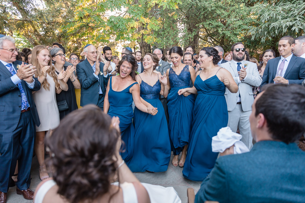 bridesmaids surprise the couple with silly dances