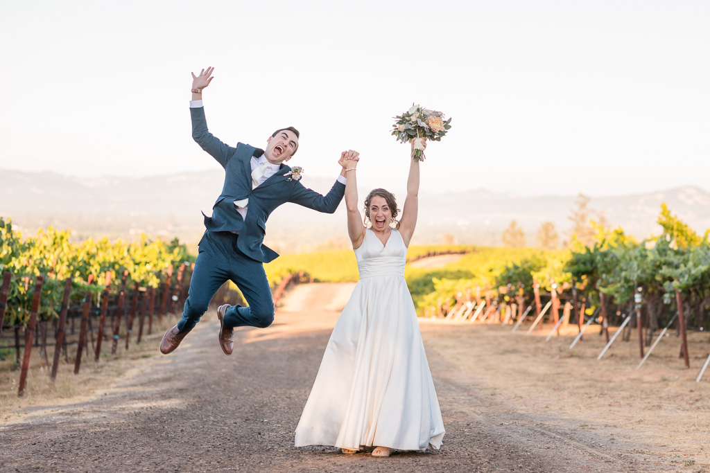 jumping photo of the bride and groom