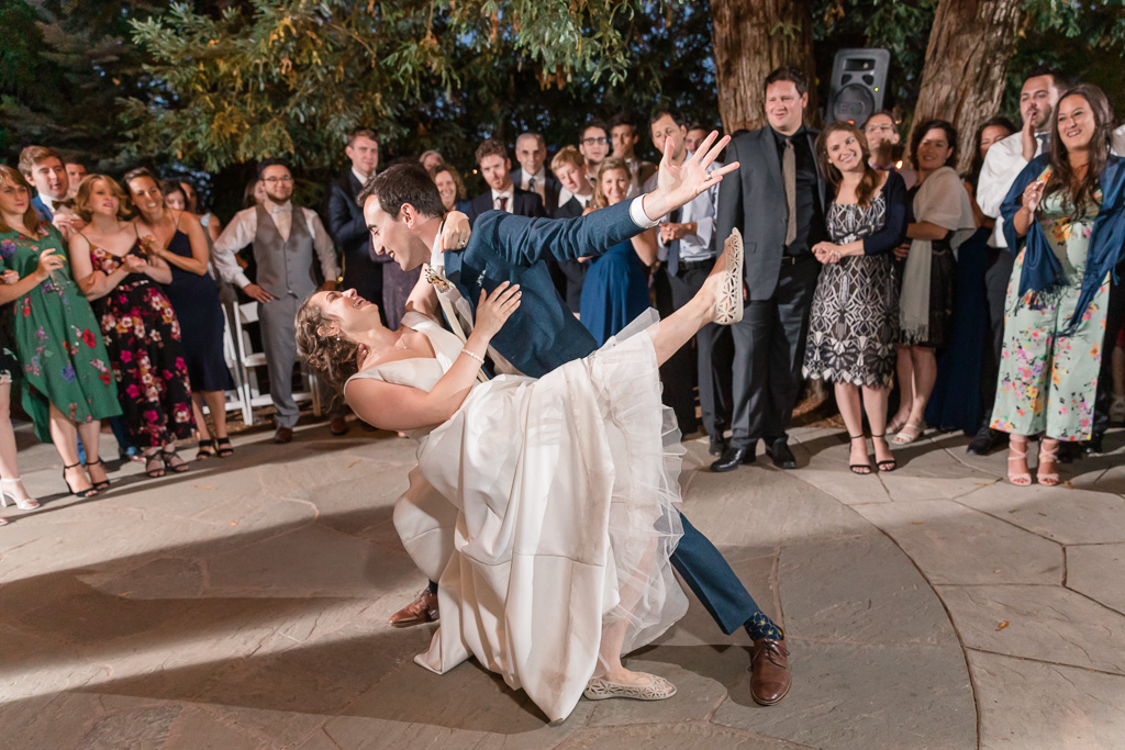 ending their first dance with a dip