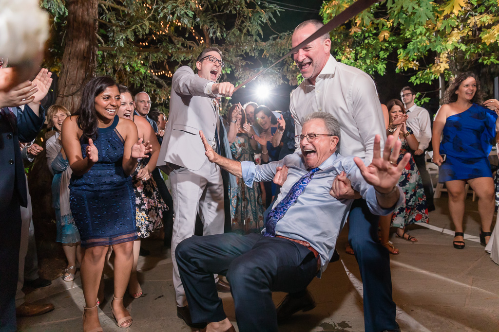 groom's dad having too much fun dancing